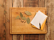 Notebook for recipes and spices. On wooden table Stock Photo