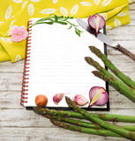 Notebook for recipes and vegetables Stock Images