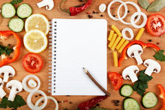 Notebook for recipes, vegetables and spices. Notebook for recipes, vegetables and spices on wooden table Stock Photography