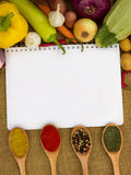 Notebook for recipes. With vegetables and spices Royalty Free Stock Image