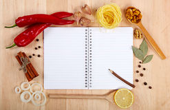 Notebook for recipes, vegetables and spices. Notebook for recipes, vegetables and spices on wooden table Royalty Free Stock Photo