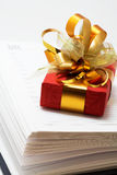 Notebook and red gift Stock Photography