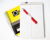 The notebook and the red handle Royalty Free Stock Images