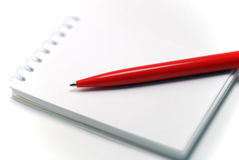 Notebook and a red pen. Close-up Stock Photo