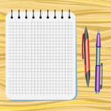Notebook, red pen and purple pen Royalty Free Stock Images