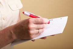 Notebook and red pen women Stock Photography