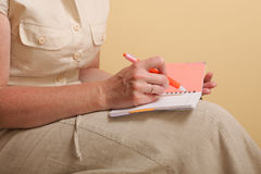 Notebook and red pen women Royalty Free Stock Photo