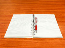 Notebook and red pen Royalty Free Stock Photos
