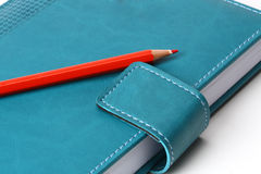 Notebook  with red penci Royalty Free Stock Photography