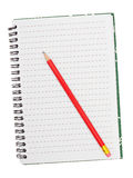 Notebook with red pencil, isolated Stock Photography
