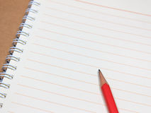 Notebook and Red Pencil Stock Images
