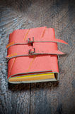 Notebook. Red Notebook  on the  wooden background Royalty Free Stock Image