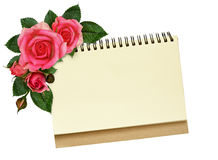 Notebook and rose flowers Royalty Free Stock Photography
