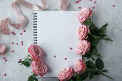 Free Notebook, Roses, Pink Ribbon And Sweet Candies In Shape Of Heart On White Background Stock Photography - 105651182