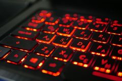 Laptop keyboard out of focus stock images