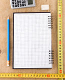 Notebook, school and office accessories on wood Royalty Free Stock Photography