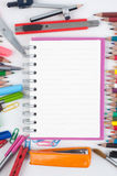 Notebook and school or office tools on white background Royalty Free Stock Photography