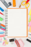 Notebook and school or office tools  on white background Stock Photography