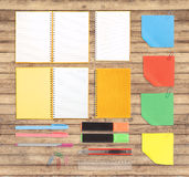 Notebook and school or office tools  on wood background And Clipping path Stock Photo