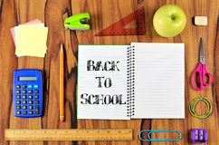 Notebook with school supplies and Back to School text Royalty Free Stock Image