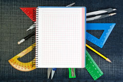 Notebook for school supplies on the jeans. Royalty Free Stock Photography