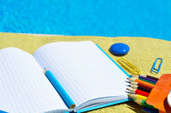 Notebook with school supplies. Stock Images
