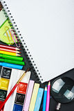 Notebook and school supplies Stock Photos