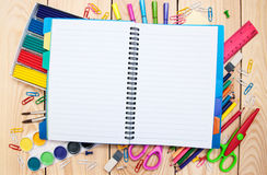 Notebook with school supplies Stock Image