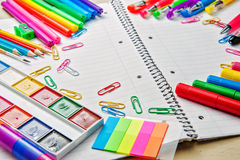 Notebook with school supplies on a wooden background Stock Images