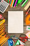 Notebook and school tools around. Stock Photography