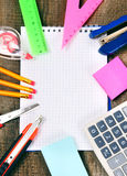 Notebook and school tools around. Royalty Free Stock Photo
