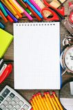 Notebook and school tools around. Stock Images