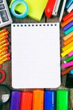 Notebook and school tools around. Royalty Free Stock Photography