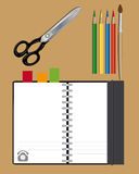 Notebook scissors and pencils Royalty Free Stock Image