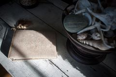 Notebook and sea shells. Old notebook laying on wooden table with sea shells Stock Photos