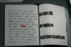 Seo keywords notebook. A notebook with seo and handwritten keywords about success and seo Royalty Free Stock Photography