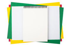 Notebook on sheets of colored paper Royalty Free Stock Photos