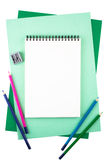 Notebook on sheets of colored textured paper imitating a frame Royalty Free Stock Photography