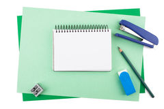 Notebook on sheets of colored textured paper imitating a frame Royalty Free Stock Image