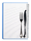 Notebook with Silver Cutlery Royalty Free Stock Image