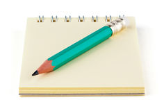 Notebook and simple pencil. On white background Royalty Free Stock Images
