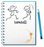 A notebook with a sketch of the baseball players Royalty Free Stock Image