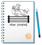 A notebook with a sketch of a boy riding a horse Royalty Free Stock Images