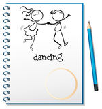 A notebook with a sketch of a girl and a boy dancing Stock Photo