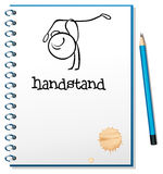 A notebook with a sketch of a person doing a handstand Royalty Free Stock Photo