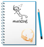 A notebook with a sketch of a person snorkling Royalty Free Stock Images