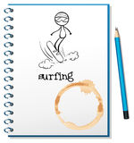 A notebook with a sketch of a person surfing Royalty Free Stock Images