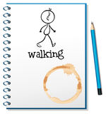 A notebook with a sketch of a person walking at the cover page Royalty Free Stock Photos