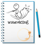 A notebook with a sketch of a person waterskiing Stock Photo