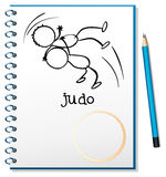 A notebook with a sketch of two people doing judo Royalty Free Stock Photos